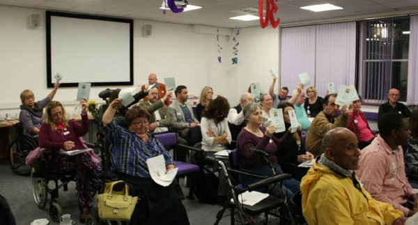 People holding up voting cards at our Annual General Meeting