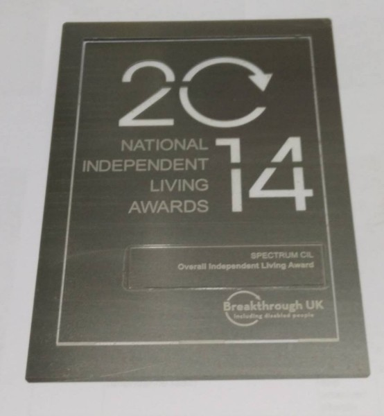 A photo of SPECTRUMs National Independent Living Award 2014 certificate