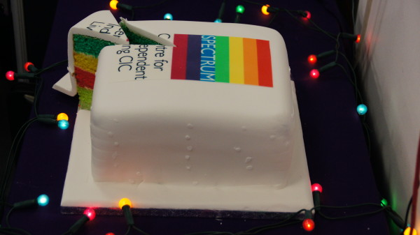 Picture of Spectrum's 30th anniversary birthday cake with our logo made up with coloured icing